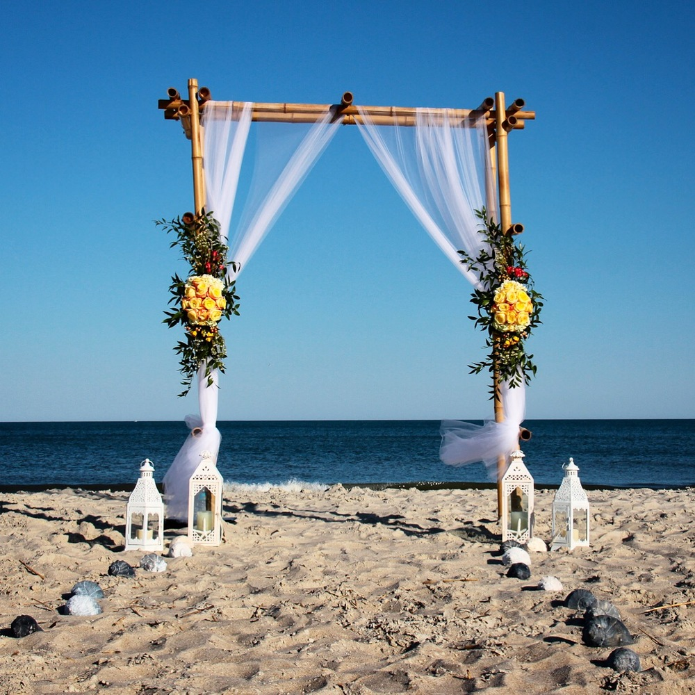 Wedding arch on the beach Hilton Head with yellow rosesHilton Head Wedding, Tybee Island Wedding, Savannah Wedding, Wedding packages, Destination Wedding, Wedding Photography, Wedding flowers, beach