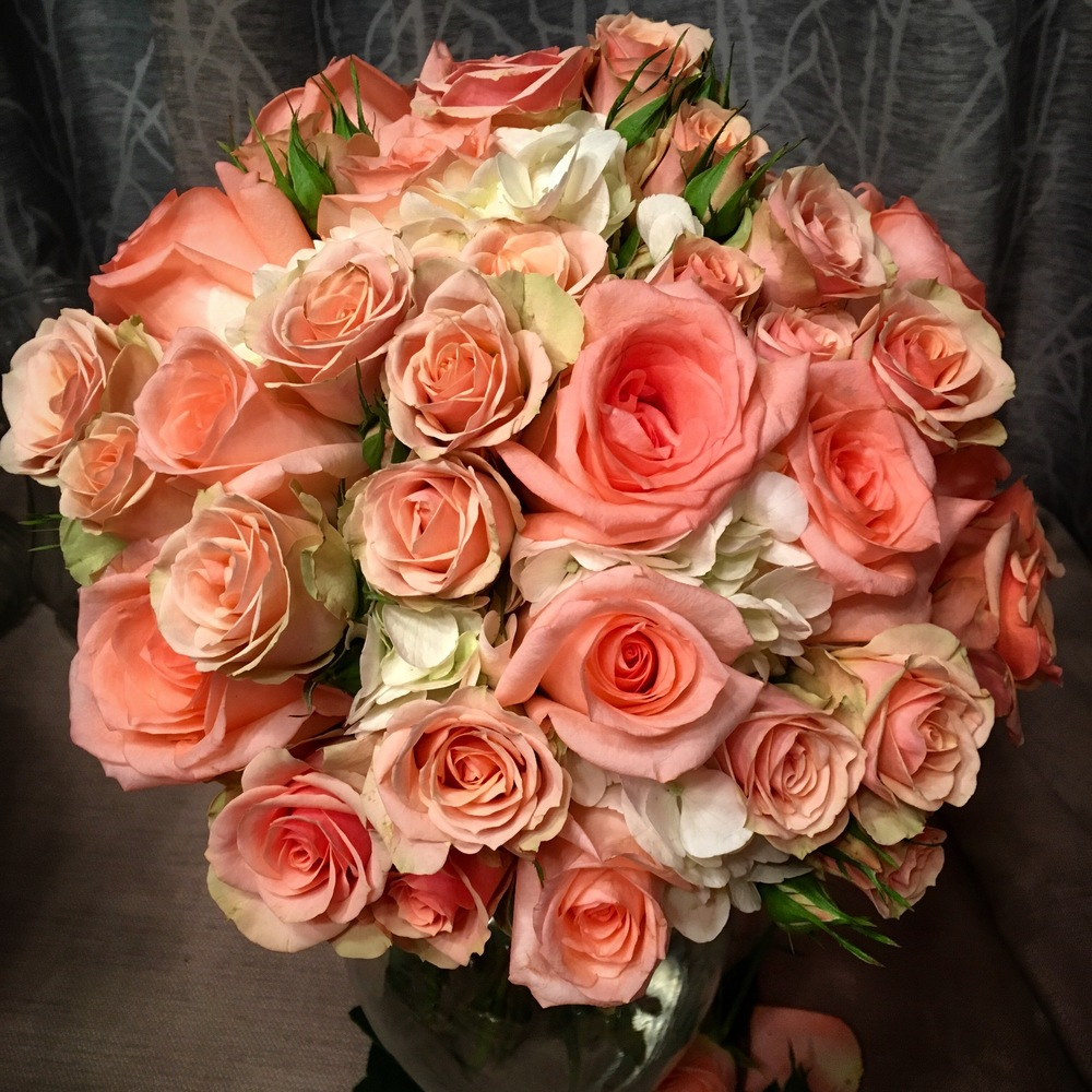 Wedding flowers coral rose brides bouquet
