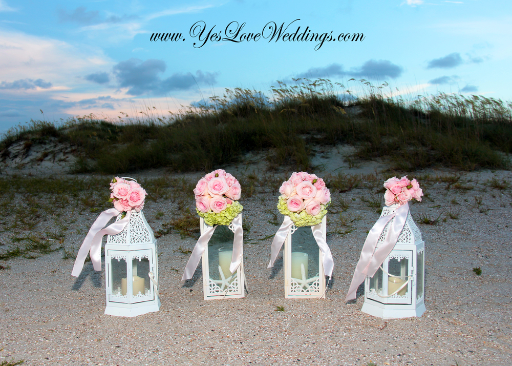 Wedding flowers pink roses on lanterns