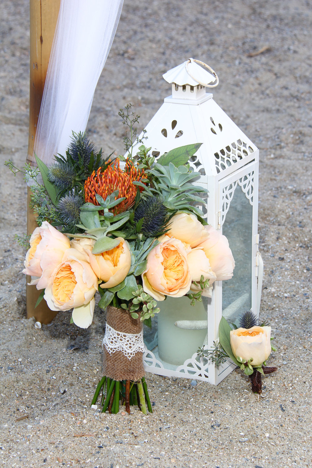 Wedding bride's bouquet succulents and peach roses beach wedding
