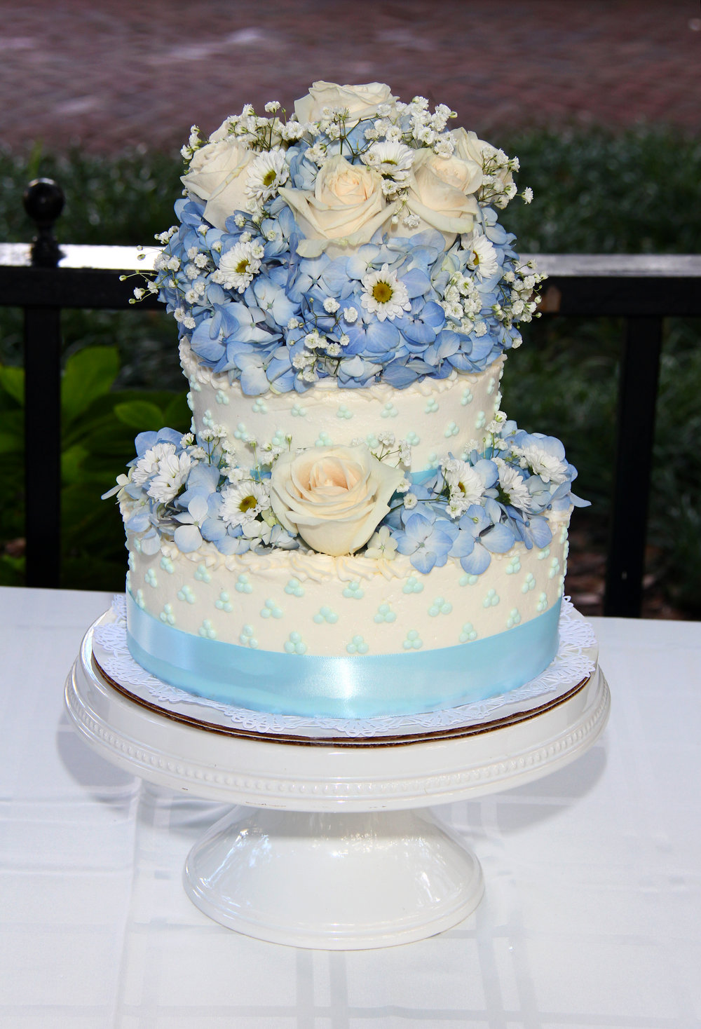 Blue and white wedding cake with flowers Savannah GA