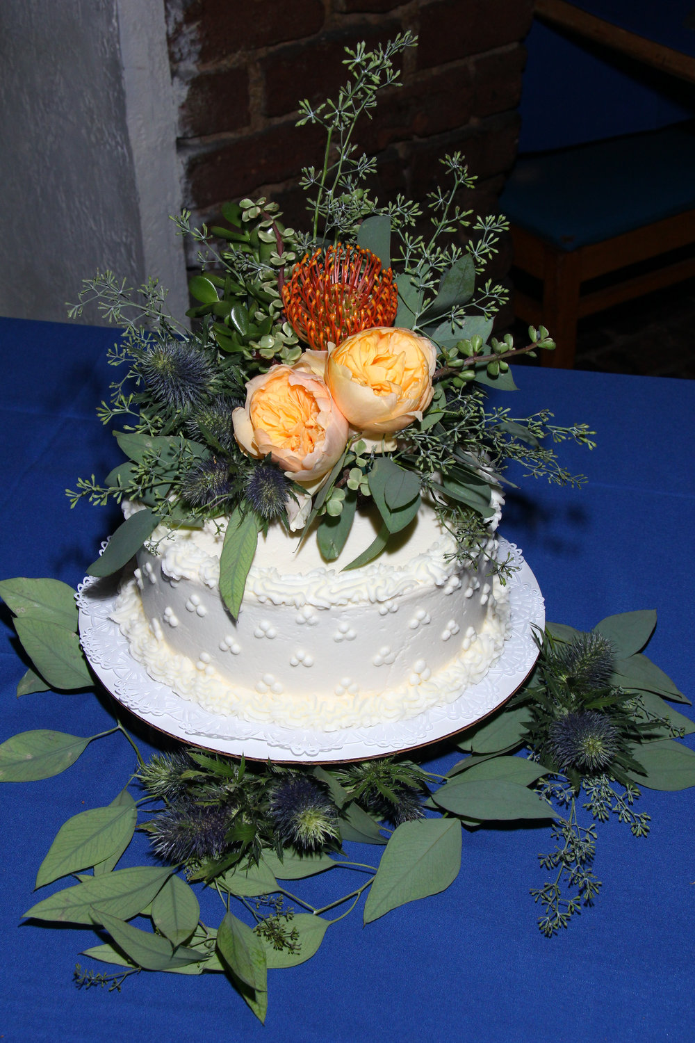 wedding cake for elopement with succulents and flowers