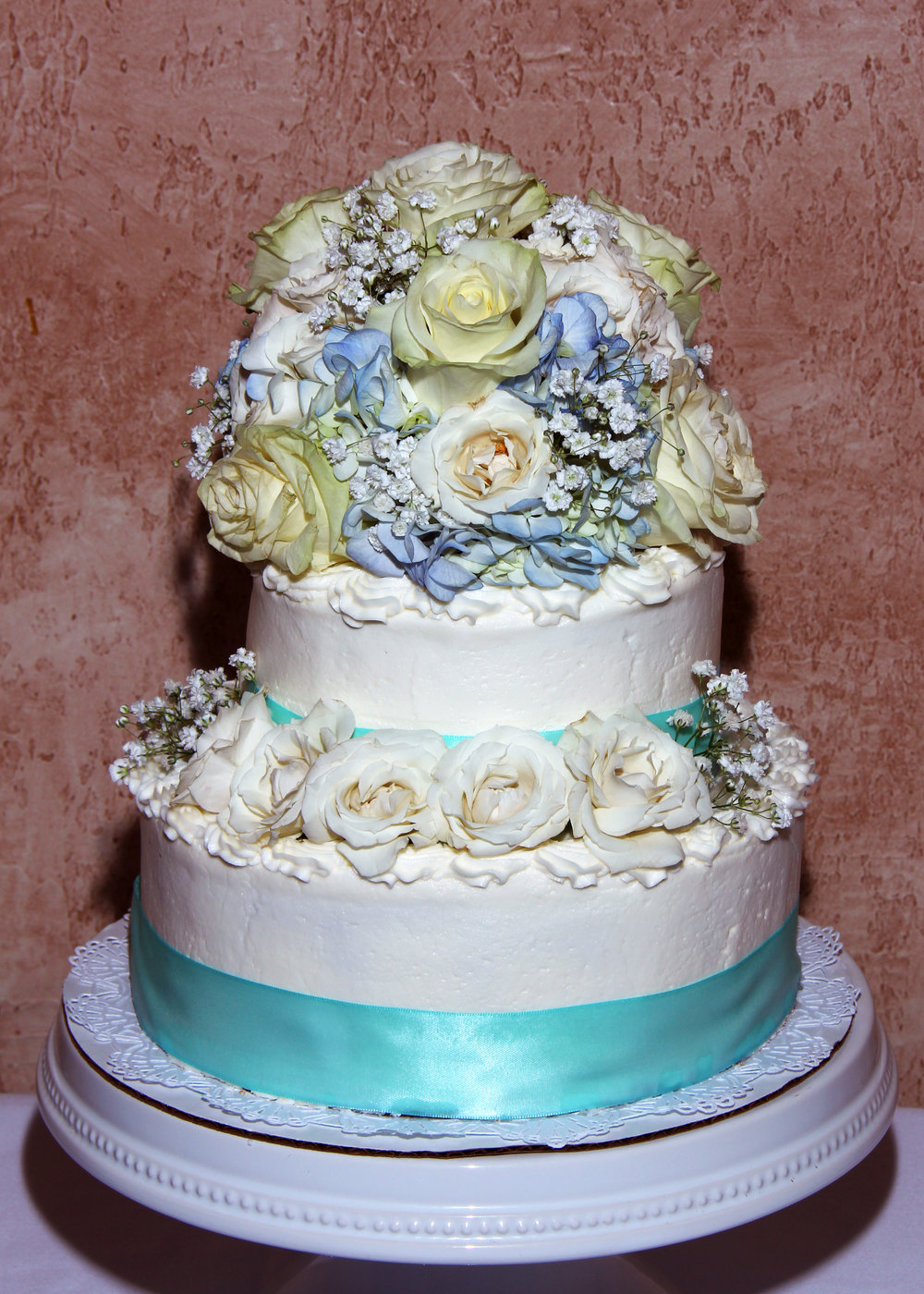 blue and white flowers on a wedding cake hilton head