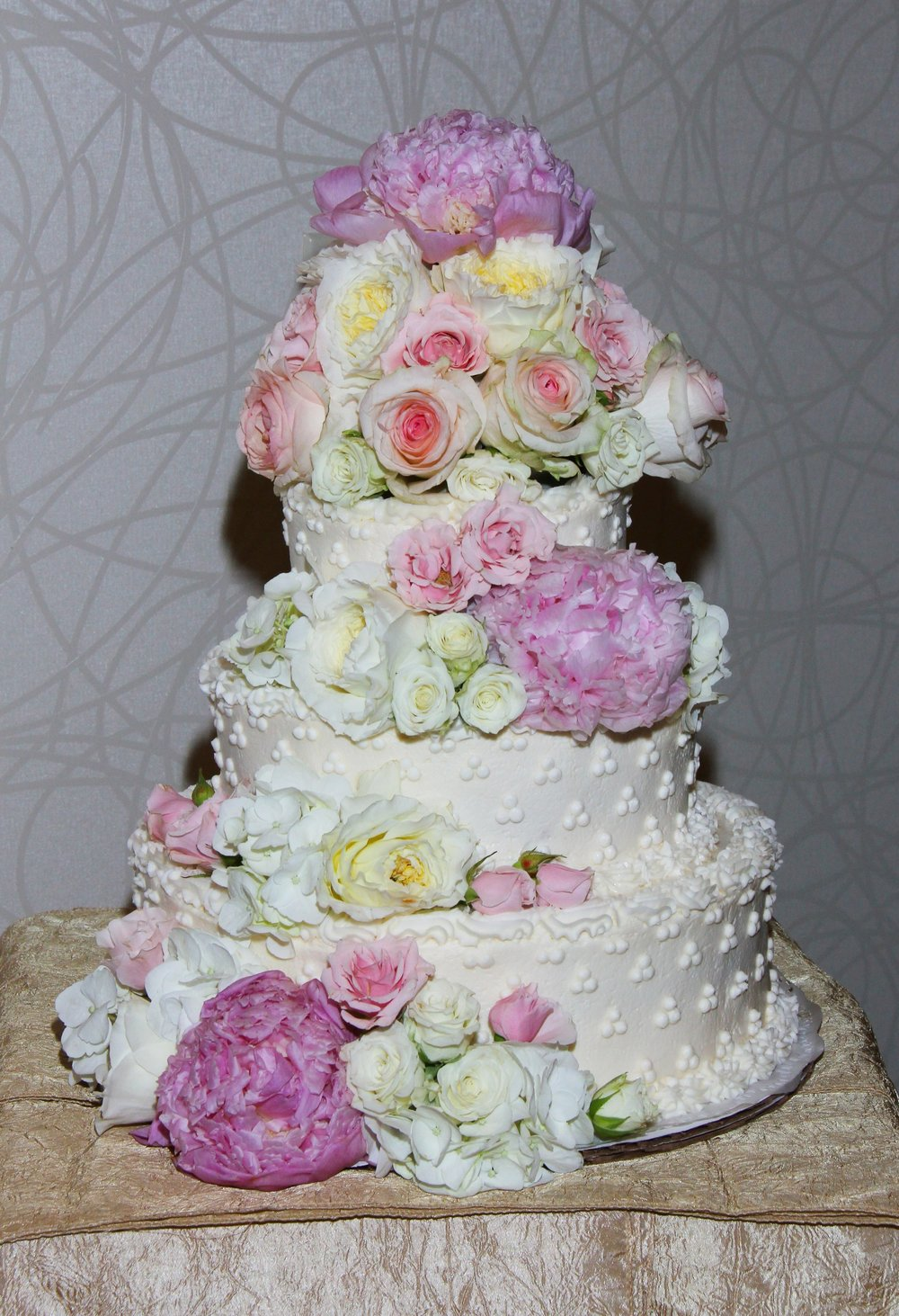 Wedding cake with peony and garden roses