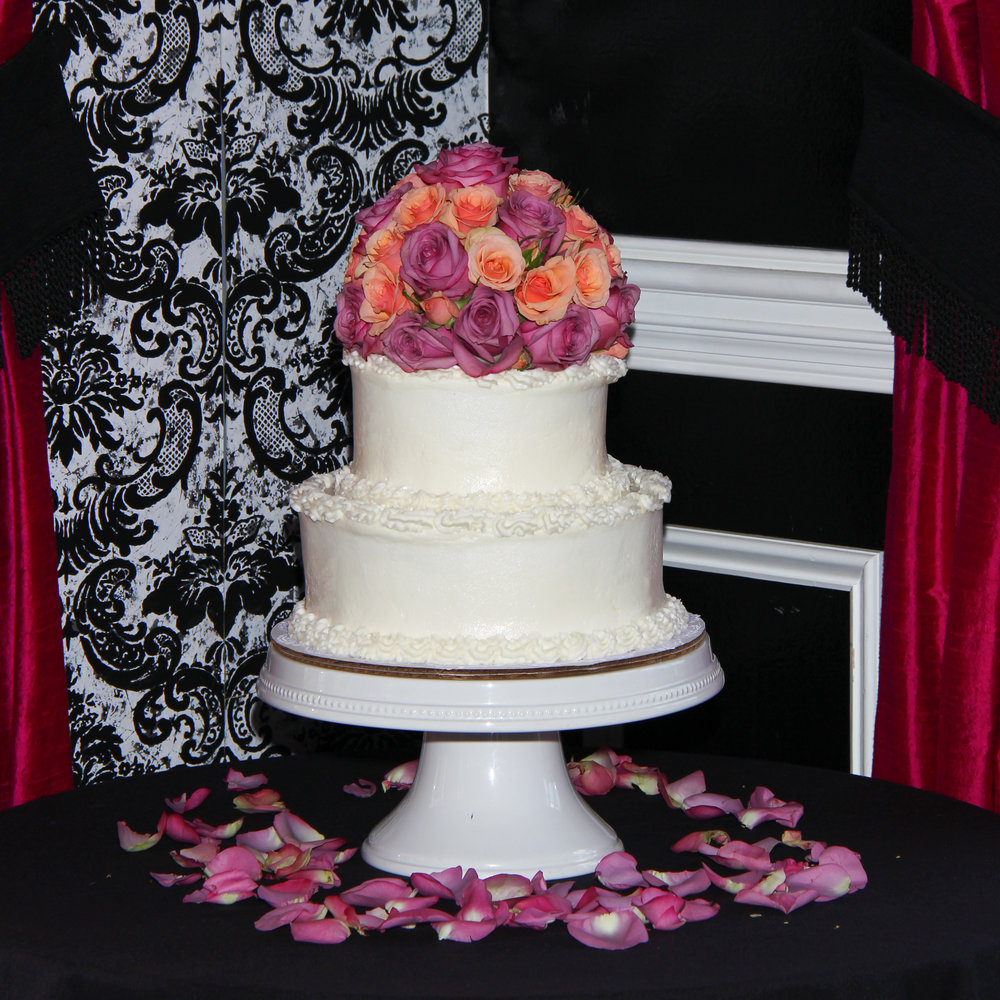 Wedding cake with Purple and peach roses Savannah Wedding Noble Fare