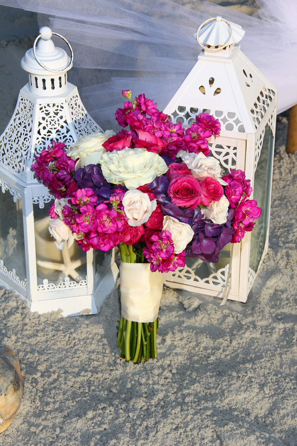 purple and white brides bouquet