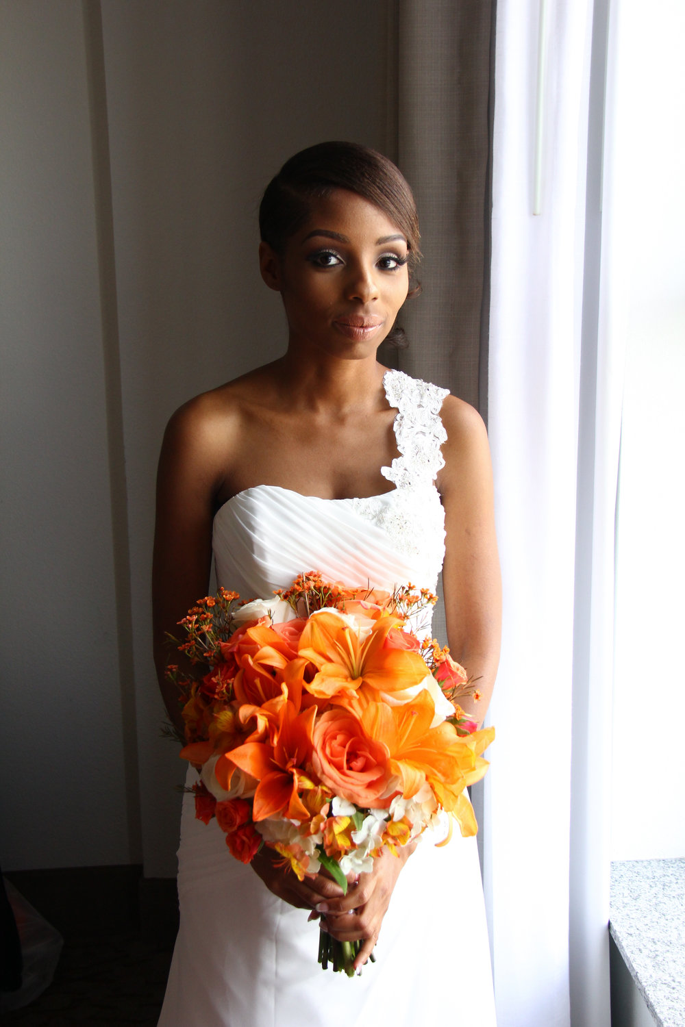Orange lily brides bouquet