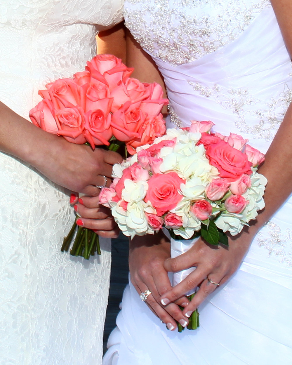 Brides bouquets with coral roses