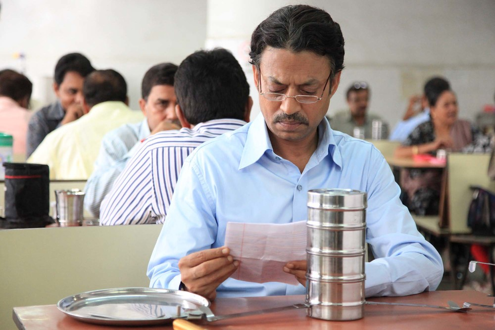 Mr. Fernandes (Irrfan Khan) reads the letter tucked inside his tiffin box in The Lunchbox. (ArtsATL)
