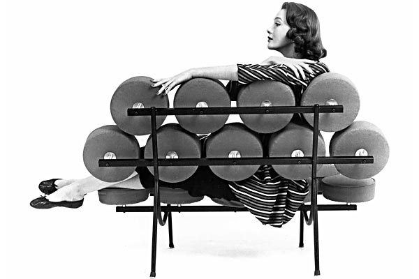 Hilda Longinotti sitting pretty on Herman Miller's Marshmallow sofa in the mid-1950s. (New York Times)