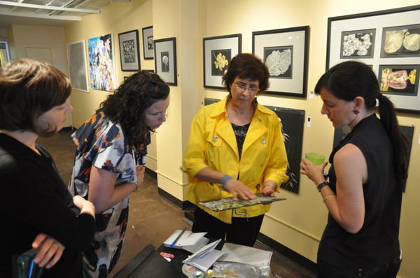 Lisa Goesling with describing art to Carolina O. Jayaram and others from the Chicago Artists Coalition. -Copyright