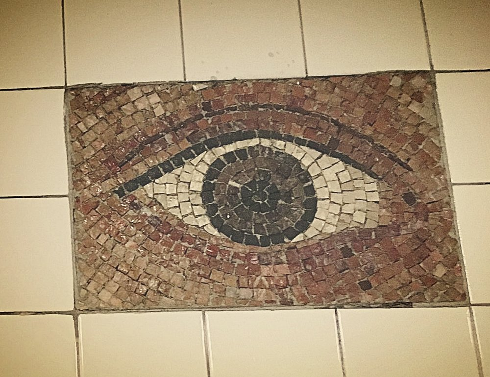 Eyeball tile mosaic at Subway station--there were several along a passageway and each eye is different.