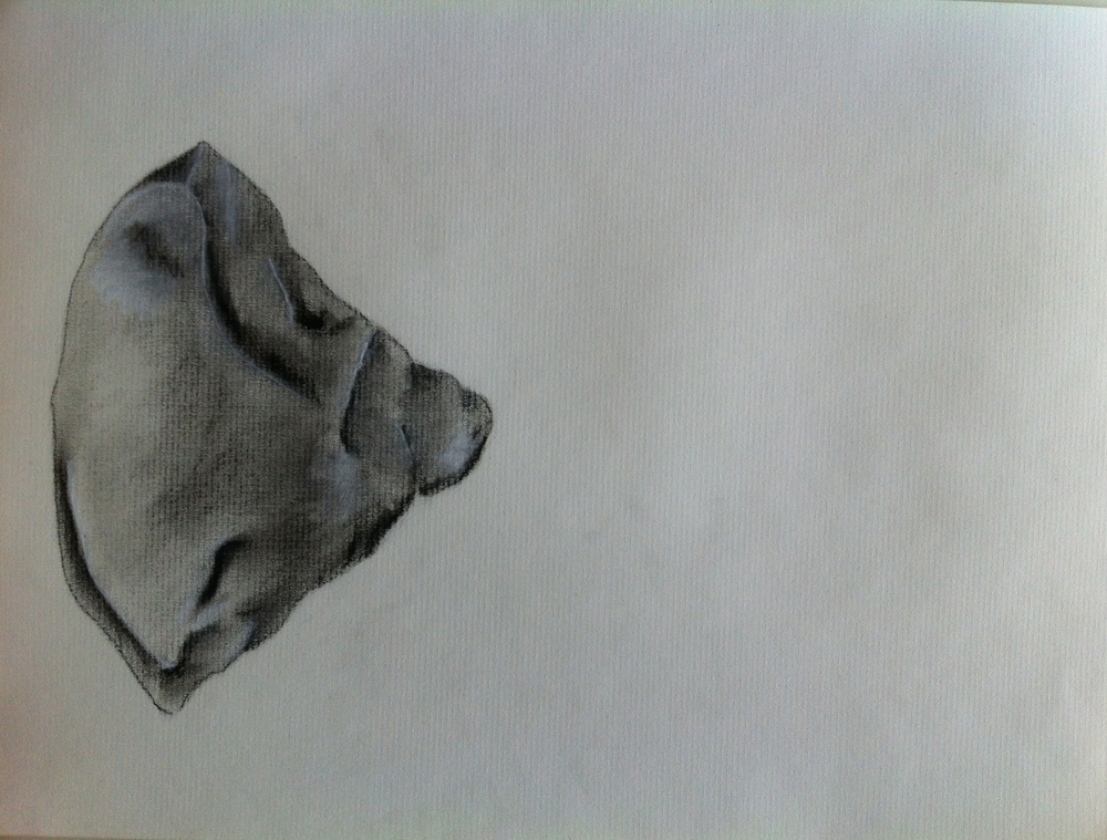 Charcoal drawing of a Paleolithic axe head