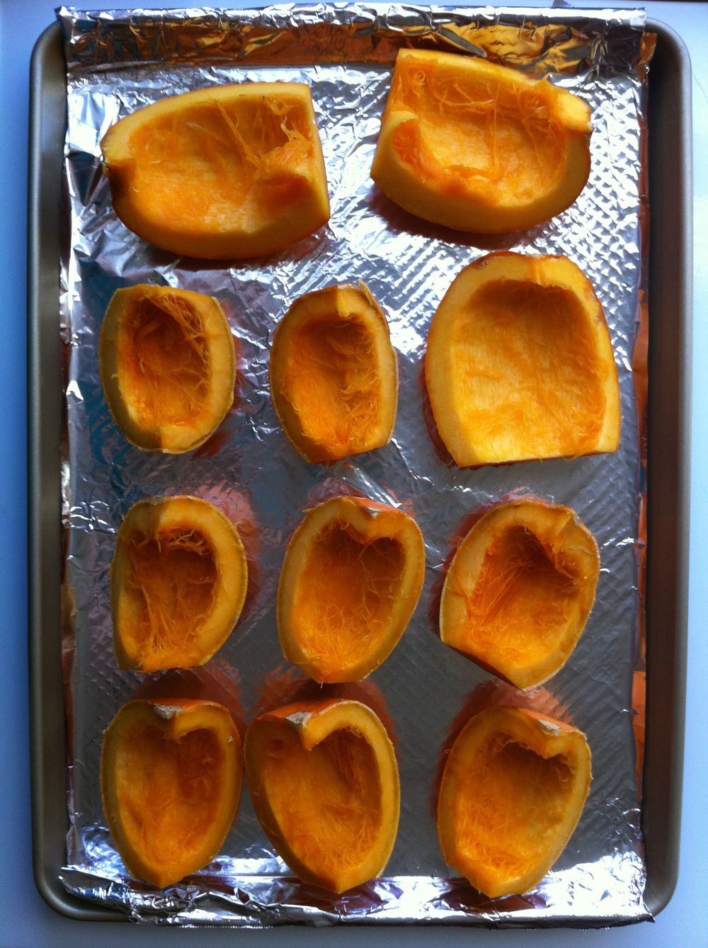 Pumpkin quarters ready for roasting