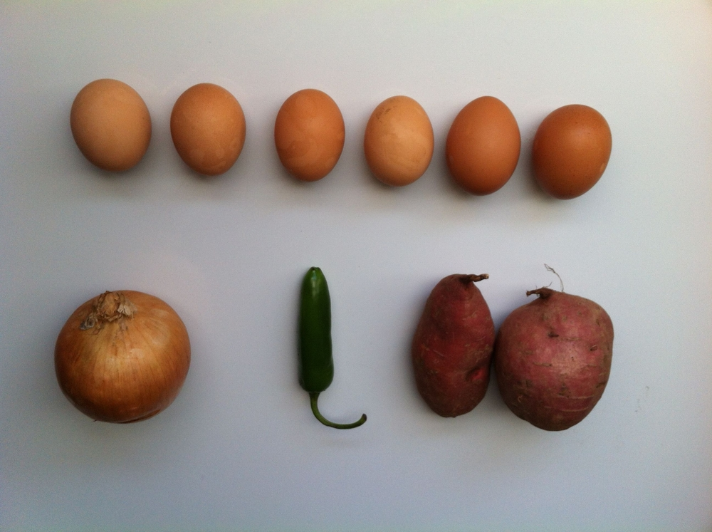 Clockwise: Eggs, sweet potatoes, jalapeno and onion