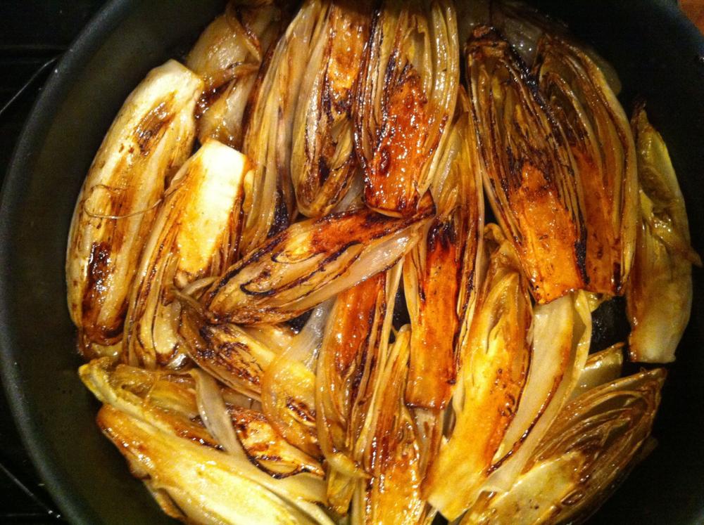 Braised Belgian Endive browning in the pan