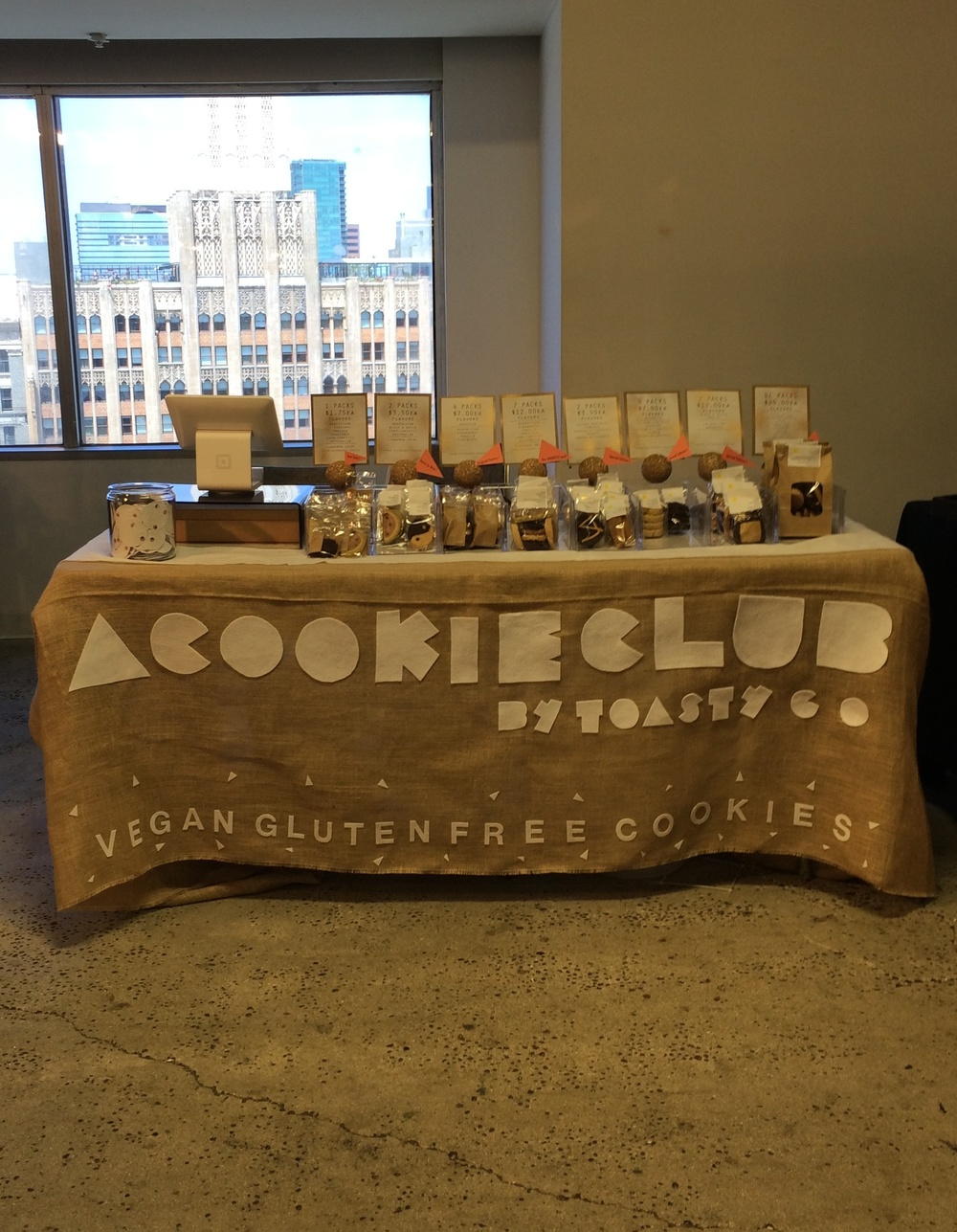 Our table, at the Unique LA spring show, with a picturesque view of the Spanish Gothic Ace Hotel and beautiful downtown LA, May 2014.