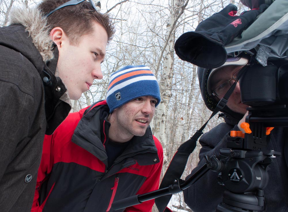 The three of us gather around the camera for playback.