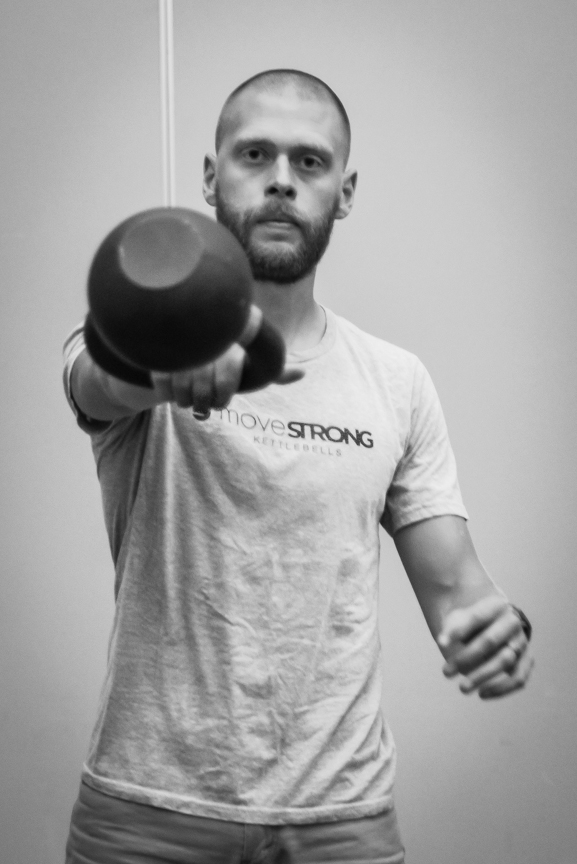 Dustin Jones, Doctor of Physical Therapy, CSCS, Strength and Movement coach, and pulled in by the kettlebell.