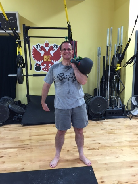 JIM, OUR FIRST MEMBER TO COMPLETE 10,000 SWINGS ,WAS AWARDED A 70# KETTLEBELL