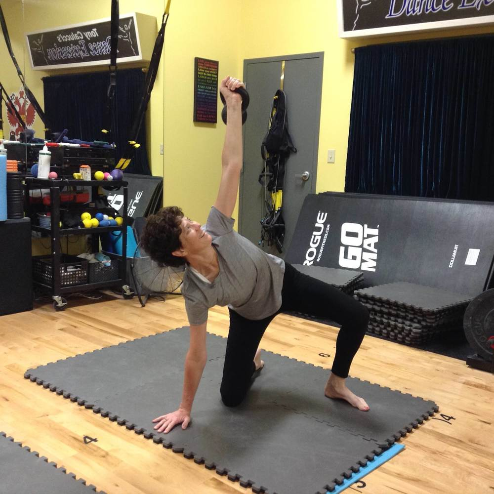 Jennifer is new to us and is learning the 7-steps of the Turkish Getup. She is a professional organizer that places serious physical demands on her body. This training will help her get stronger and know how to move, lift and carry heavy boxes and other items on the job.