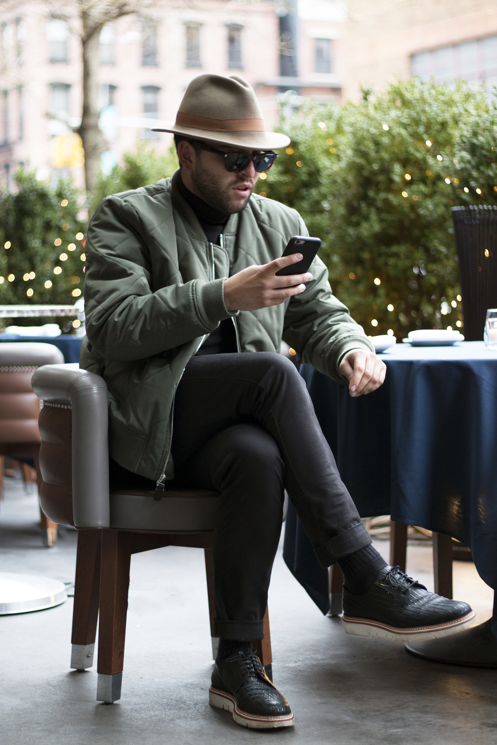 Pensively, awaiting the arrival of an Uber. Jacket: 7 For All Mankind/ Hat: Rag & Bone / Shoes: Jimmy Choo