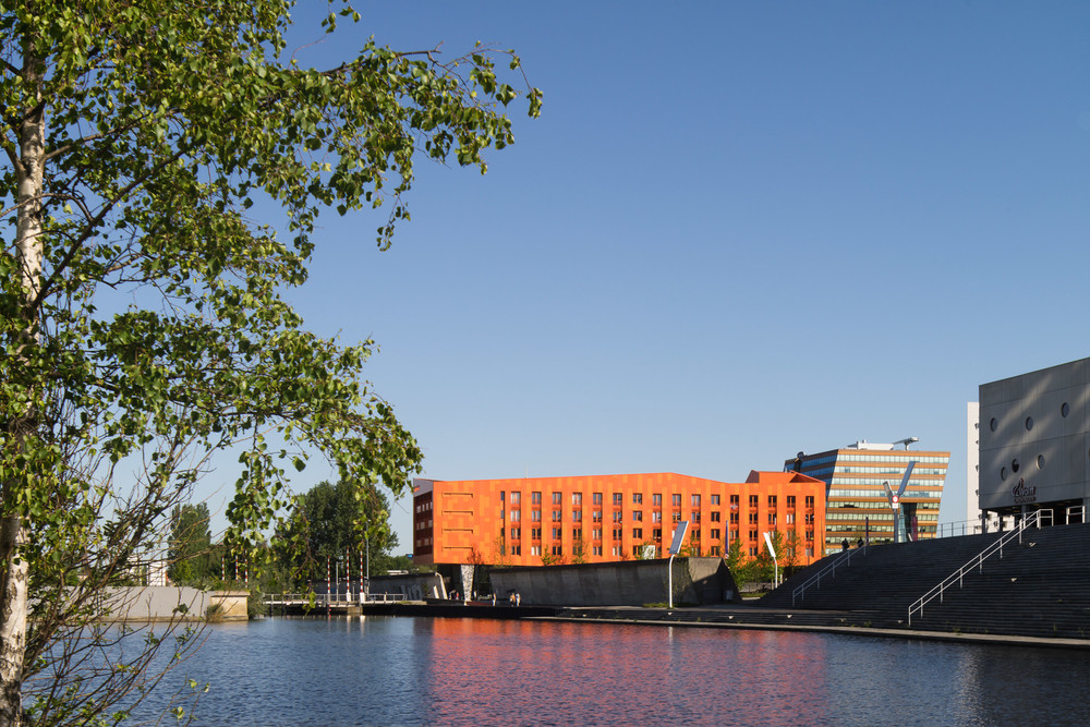 view across the water of hete kolen by team 4 architecten