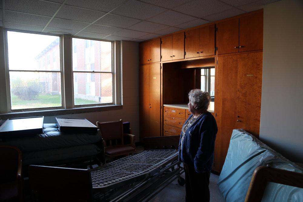 Rose Brooks standing in her old dorm room Lynchburg, Virginia