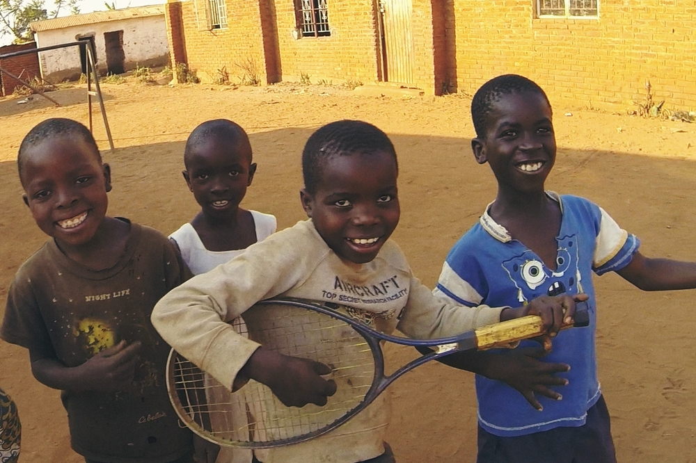 Boys playing in a small village in Malawi, Africa.