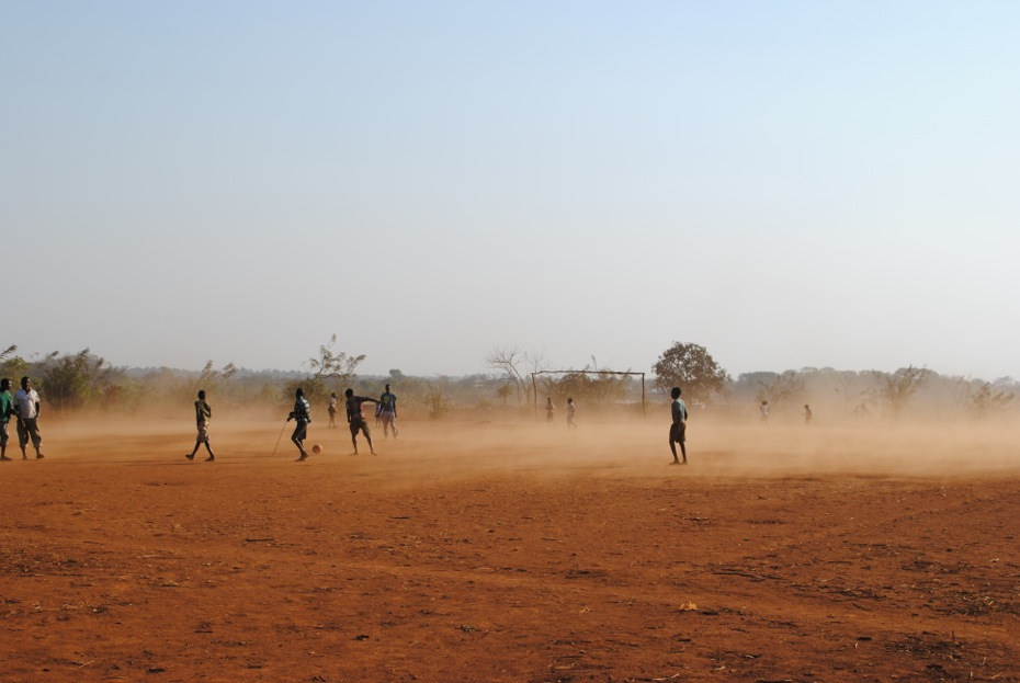 Playing soccer in a field in Malawi, Africa.