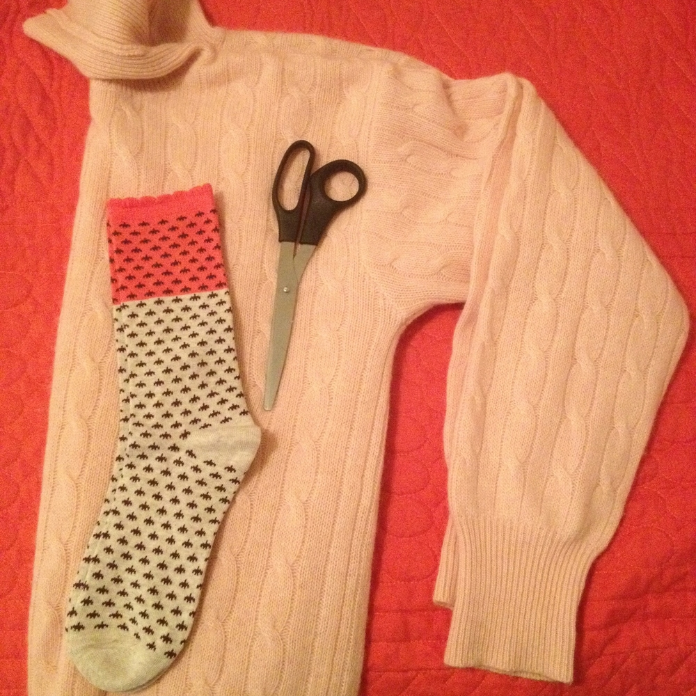 Supplies:  -Pair of scissors  -Old sweater  -Pair of decorative socks