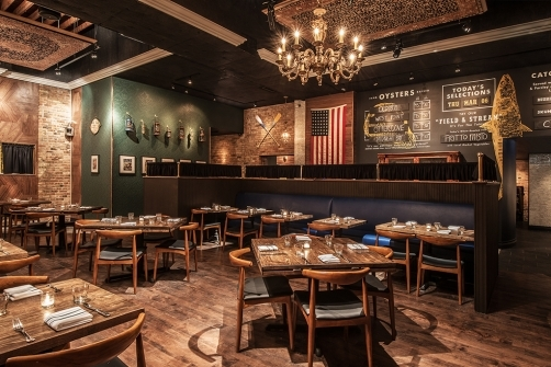 """""""This endeavor from Element Collective in River North offers sustainable seafood in a sportsman's club atmosphere replete with pages of Field & Stream magazine on the walls."""" Read more at Nation's Restaurant News"""