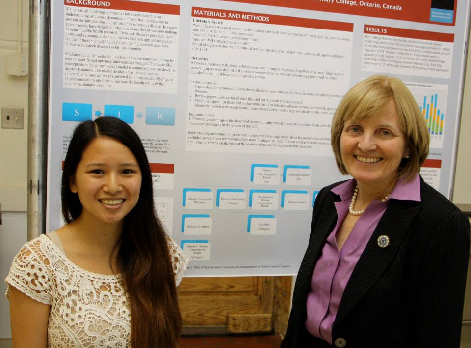 Beverly discusses her research with OVC Dean Dr. Elizabeth Stone at the summer student leadership and research program (SLRP) final poster session in August 2014.