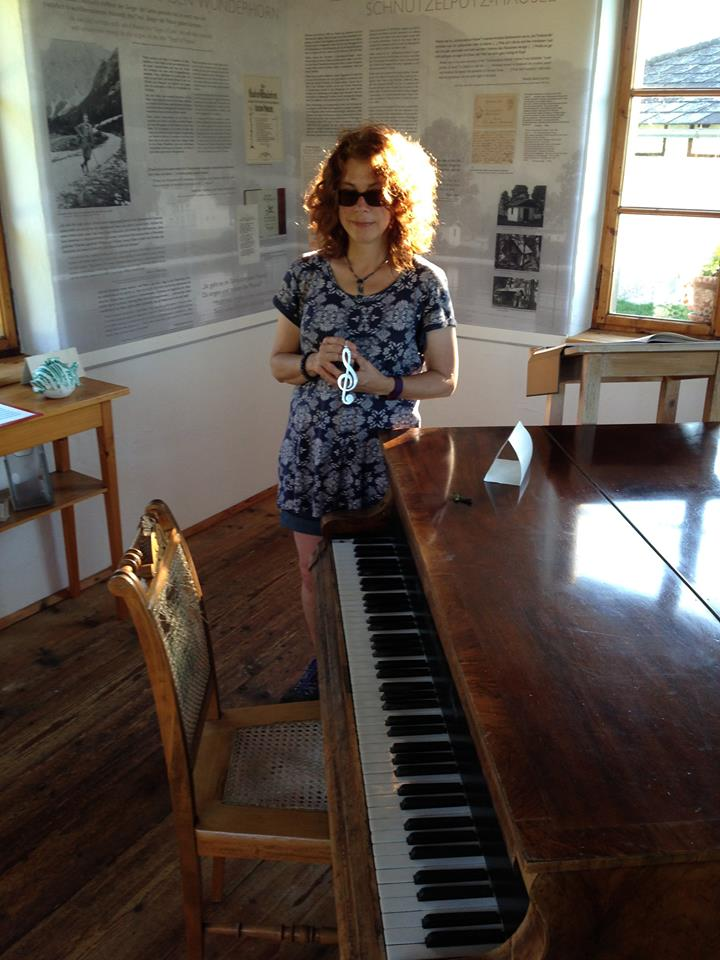 mary sharratt with piano.jpg