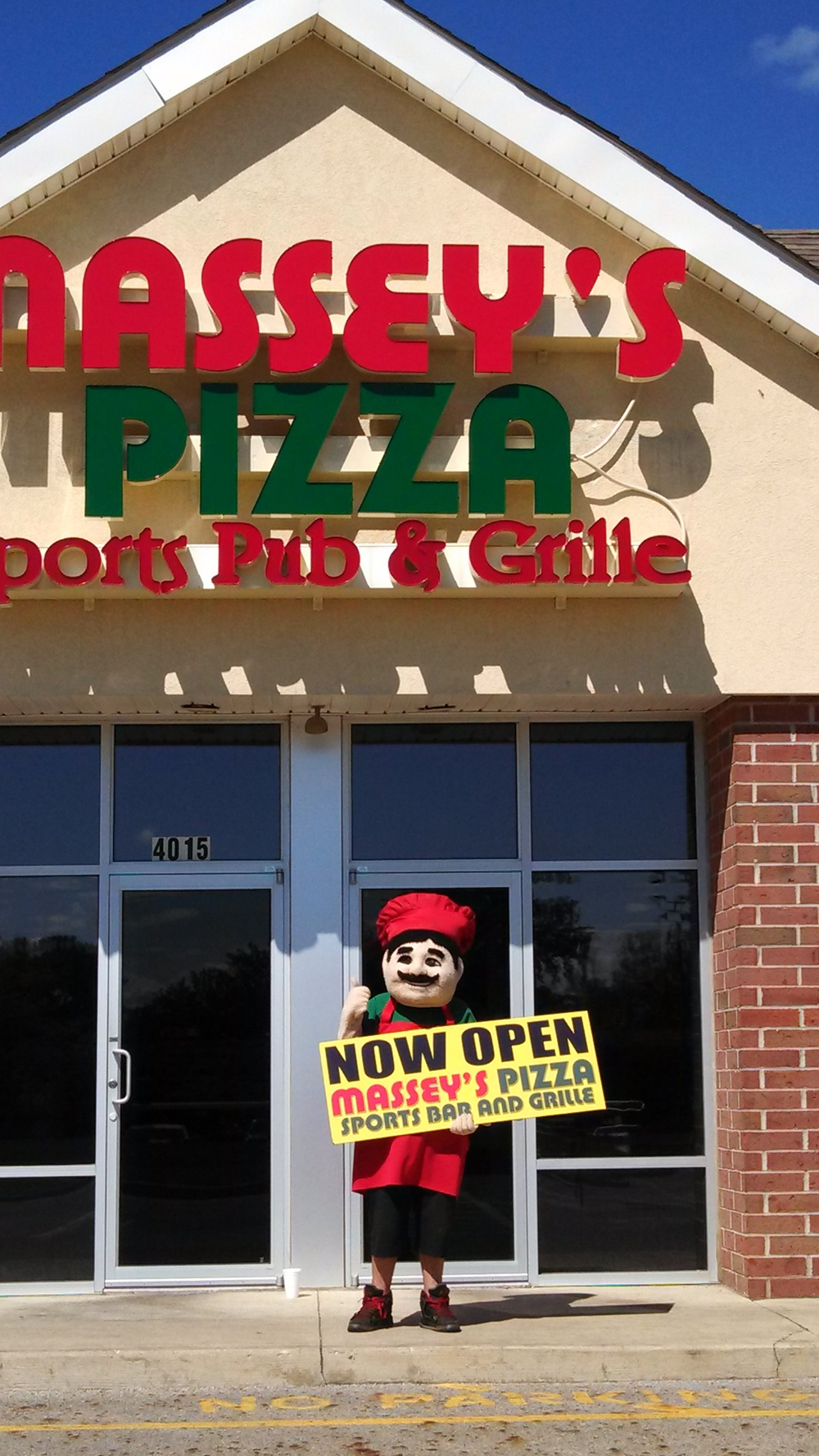 guido with now open sign.jpg