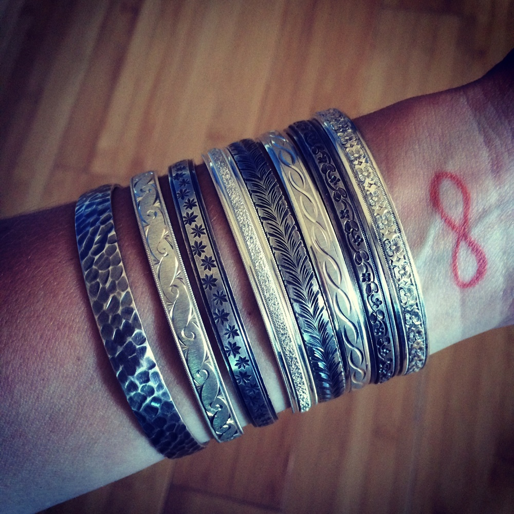 STACKED New York Argentium silver stacking bangles (from left to right): Houston, Lenox, Greenwich, Chrystie, Prince, Columbus, Spring, and Baxter.