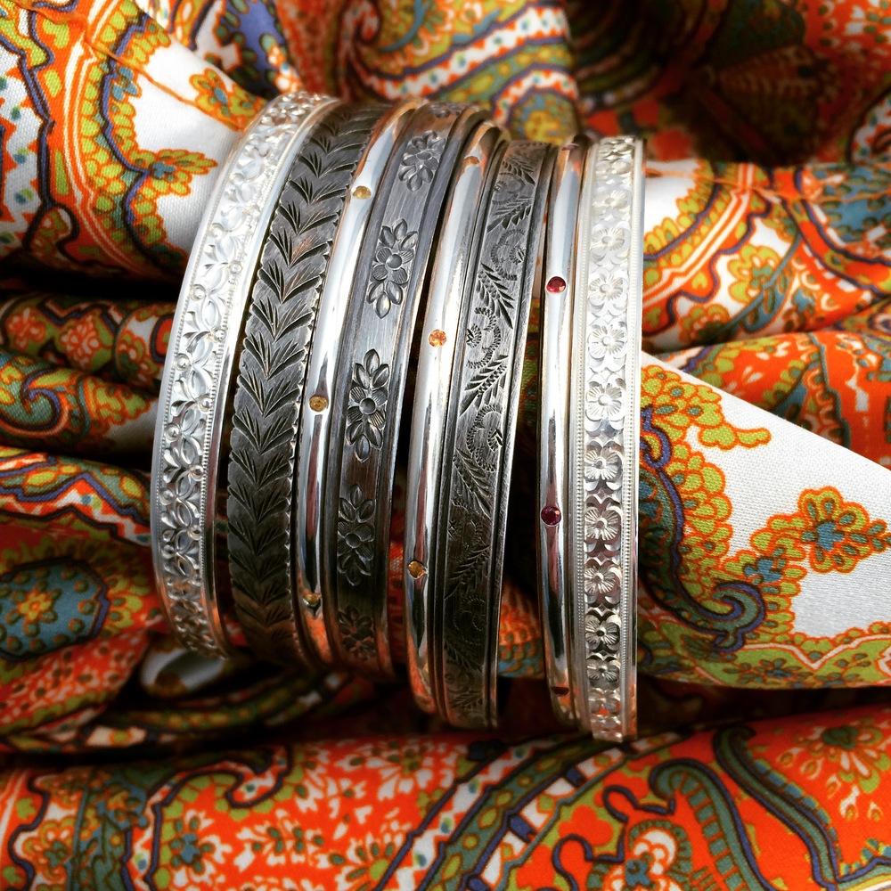 Argentium silver bangles left to right: Mercer, Prince, York St. Yellow, Bond, Orange St., Bleecker, Riverside Dr. Red, Baxter.