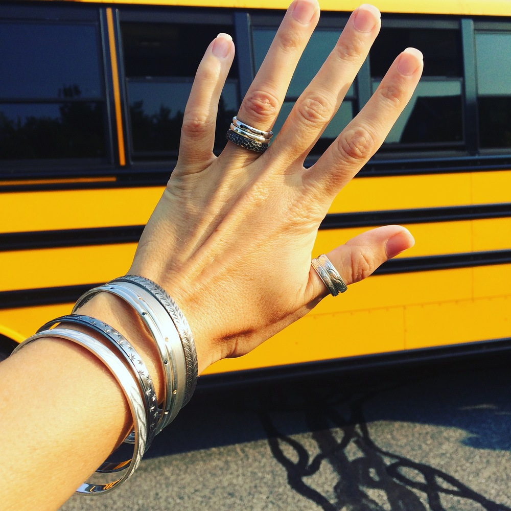 Bus stop bling: Argentium silver stacking bangles and stackable bands.