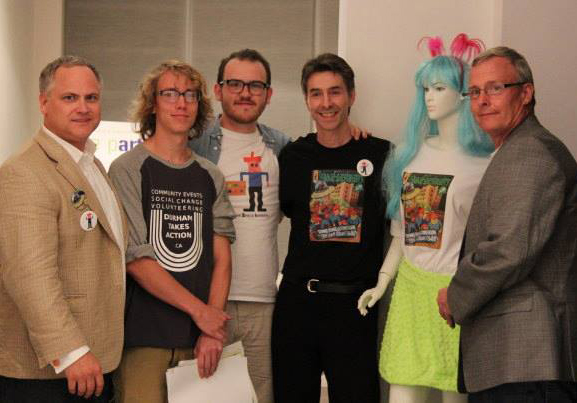 Grant Cole (OSI organizer),Jeremy Smyth (Chief Inspiration Officer at the Open Vault), Evin Lachance (Space Invaders artist liason), Steven Frank (OSI organizer) and Oshawa Mayor John Henry with our lovely Space Invader t-shirt model. (photo courtesy of Bob T. Bell)