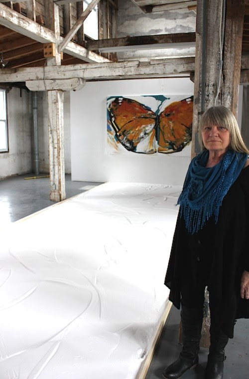 Rowena Dykins at the  Visual Arts Centre of Clarington  with her Monarch installation with 1 ton of table salt!