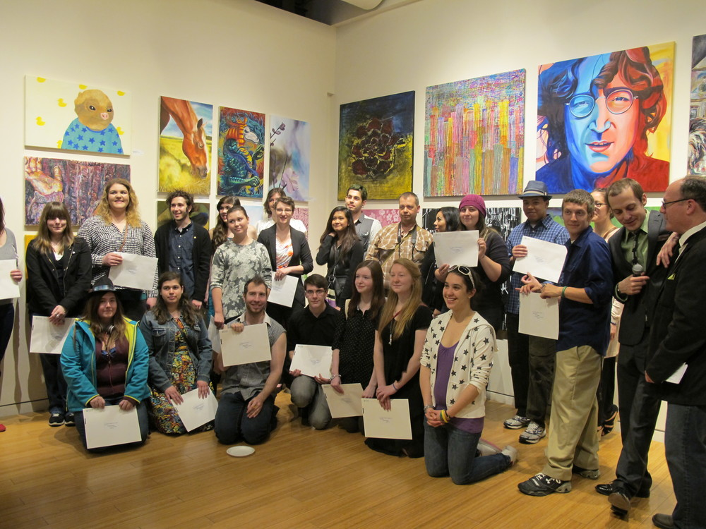 Olexander Wlasenko , Station Gallery Curator with Sean McQuay on far right with the many award winning Durham College Arts students at the annual exhibition at  Whitby's Station Gallery .