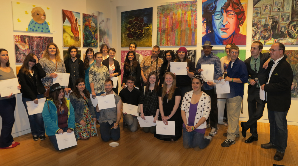 Olex Wlasenko, Station Gallery Curator, leaning on Durham College School of Media, Art & Design Prof. Sean McQuay on far right with the many award winning Durham College Arts students.
