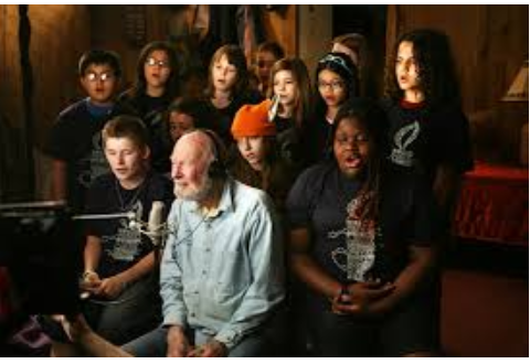 Pete Seeger, singing with the audience he said was his favorite -- kids!
