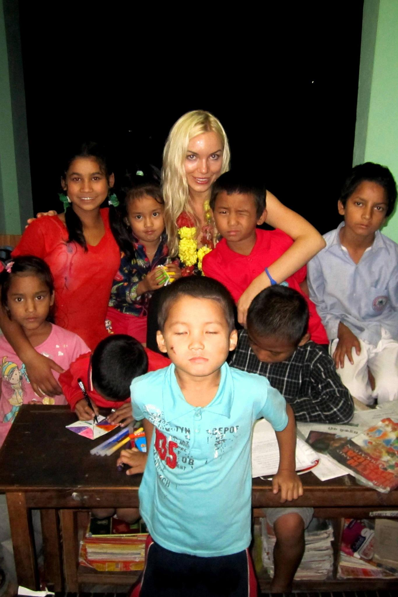 Zoryana Yavorski with children in Nepal