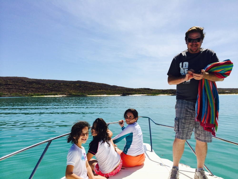Jeff Gill and his daughters enjoying the sunshine and turquoise blue water just off Coronado Island