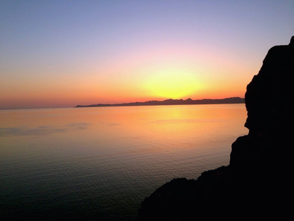 View of the sun rising over Carmen Island from the top of Nopolo Rock. Photo by Rachel Reynolds.