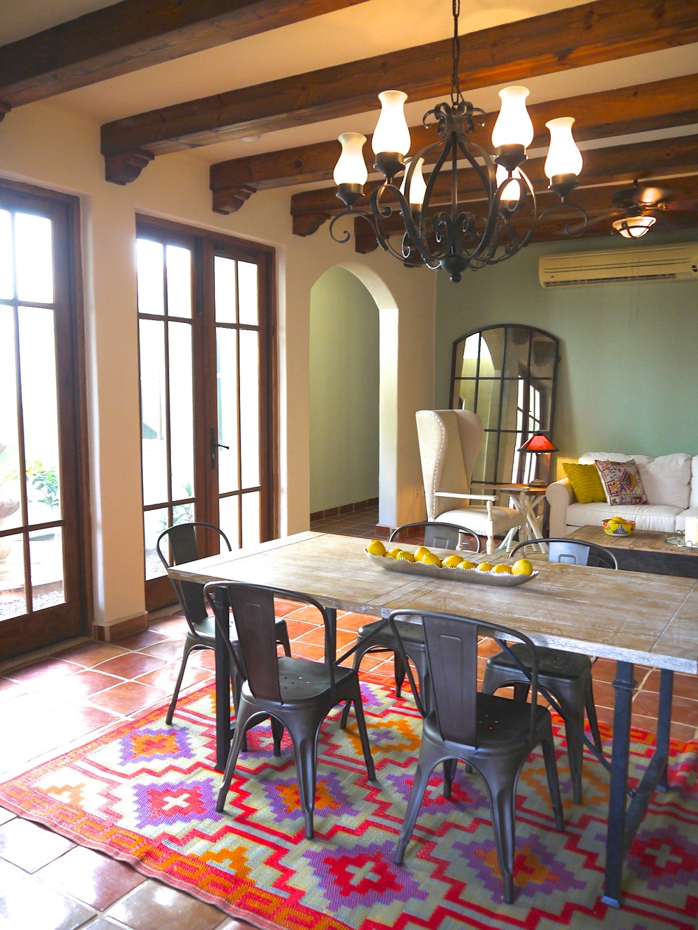 Dining table, doors leading out to private fountain courtyard