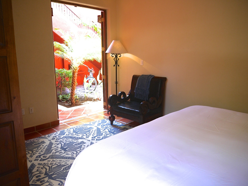 Ground floor master bedroom opening onto main fountain courtyard that the villa is built around