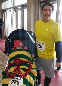 Jason Kasperski, shown at the UW Running Club Valentine's 5k with daughter Brittney. Photo credit:  Krissy Schintgen