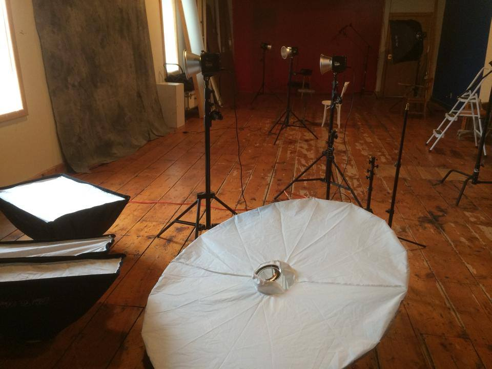 Lights, backdrops, and cameras come to play together at the Focal Flame Photography studio.